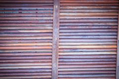 Red grungy wooden light gap background. Brown wooden battens wal Royalty Free Stock Images