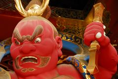 Red guardian god. Statue of wrath-filled guardian at Nikko, Japan Royalty Free Stock Image