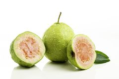 Red guava cut on white background.  stock image