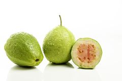 Red guava cut on white background.  stock photos