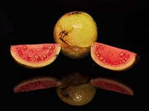 RED GUAVA ISOLATED ON BLACK BACKGROUND. Red guava isolated black background fruits vitamin stock photo