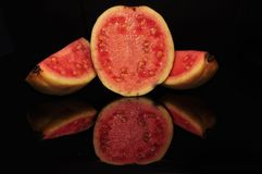 RED GUAVA ISOLATED ON BLACK BACKGROUND. Red guava isolated black background fruits vitamin stock photos