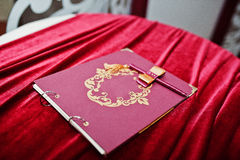 Red guest book on silk table at wedding party Royalty Free Stock Image
