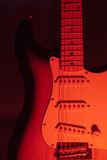 Red guitar. Passion and electric guitar in red light Royalty Free Stock Photography