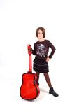 Cute Young Female & Red Guitar. Brunette little girl and her red guitar Royalty Free Stock Images