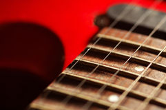 Red guitar. Close-up of a red electric guitar Royalty Free Stock Photos