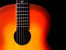 Red Guitar. Isolated on black background Stock Images