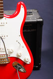 Red guitar on amplifier. Closeup photo Royalty Free Stock Photo