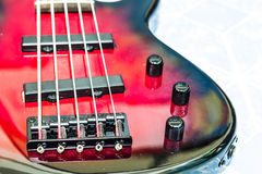 Red electric bass guitar royalty free stock images