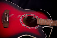 red guitar on black background Stock Image