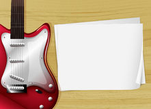 A red guitar with an empty piece of paper Stock Photos