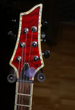 Red Guitar Headstock. Closeup of a Red Guitar Headstock with Purple Pick stock photos