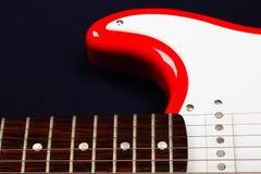 Red guitar part. Closeup photo Royalty Free Stock Image