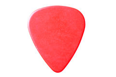 Red guitar pick up close isolated Royalty Free Stock Image