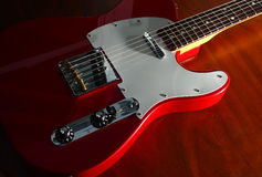 Red Guitar, side lit Stock Photos