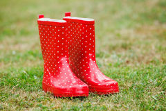 Red gumboots. In garden grass Royalty Free Stock Photography