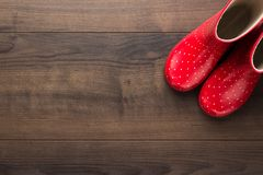 Red gumboots on the floor stock photo