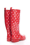 Red gumboots with white polkadot from the back Stock Images
