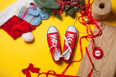 Red gumshoes near a Christmas gifts Royalty Free Stock Photos