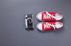 Red gumshoes and retro camera Royalty Free Stock Photography