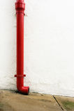 Red gutter in white wall Stock Photography