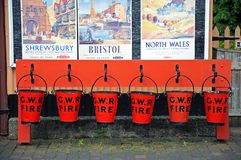 Red GWR fire buckets, Hampton Loade. Royalty Free Stock Image