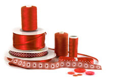 Red haberdashery / craft items on white background Royalty Free Stock Photography