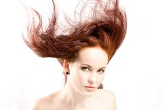 Red hair. Billowing around in studio stock photo