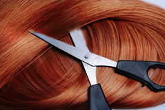 Red Hair. Long healthy red hair and professional scissors Stock Photos