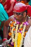 Red hair band Thaipusam pilgrim at Batu Cave Stock Photos