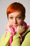Red hair. The beautiful girl with red hair, a pink scarf Stock Photo