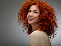 Red Hair. Beautiful Woman with Curly Hair. High quality image. Stock Photography