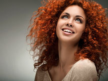 Red Hair. Beautiful Woman with Curly Long Hair. Royalty Free Stock Photos
