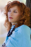 Red hair blue scarf Royalty Free Stock Photo