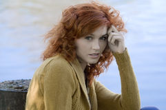 Red hair blue water Royalty Free Stock Images