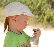 Red hair boy open air with water bottle Stock Photography