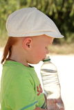 Red hair boy open air with water bottle Stock Photos