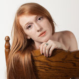 Red Hair, Brown Chair Royalty Free Stock Photography