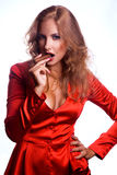Red hair Business woman in red jacket with cigaro Royalty Free Stock Photo
