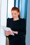 Red hair business woman with tablet in office Stock Image