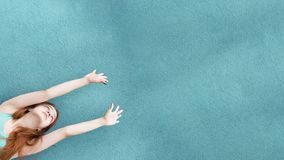Red hair charming girl hands up stock photos