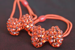 Red hair clips. With crystals stock image