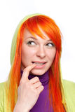 Red hair curious woman with finger at mouth Royalty Free Stock Image
