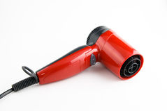 Red hair dryer. On a white background Stock Photo