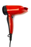 Red hair dryer. Beautiful red hair dryer on a white background Royalty Free Stock Image
