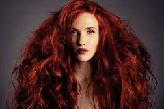 Red Hair. Fashion Girl Portrait. Fashion Portrait of Girl with Red Hair royalty free stock photography