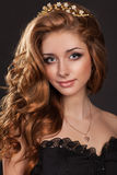 Fashion woman with brown hairs perfect skin and makeup in jewelry. Beauty Model Royalty Free Stock Image