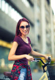 Red hair girl with bike outdoor Stock Image