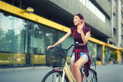 Red hair girl with bike outdoor Royalty Free Stock Photos