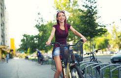 Red hair girl with bike outdoor Royalty Free Stock Images